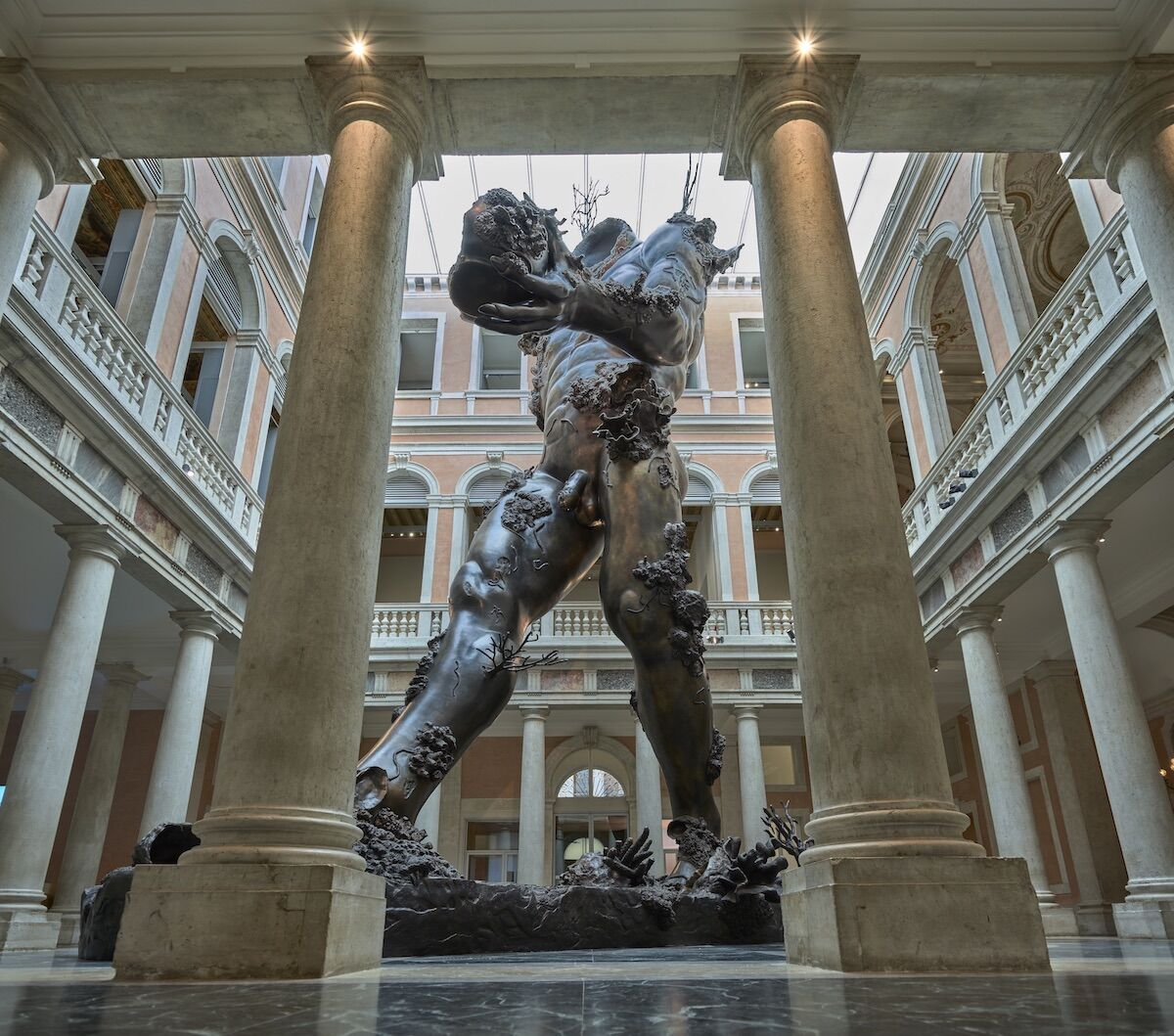 """Damien Hirst, Demon with Bowl, 2014, as installed in Palazzo Grassi in """"Treasures from the Wreck of the Unbelievable."""" Photo by Prudence Cuming Associates, © Damien Hirst and Science Ltd. All rights reserved, DACS 2019."""