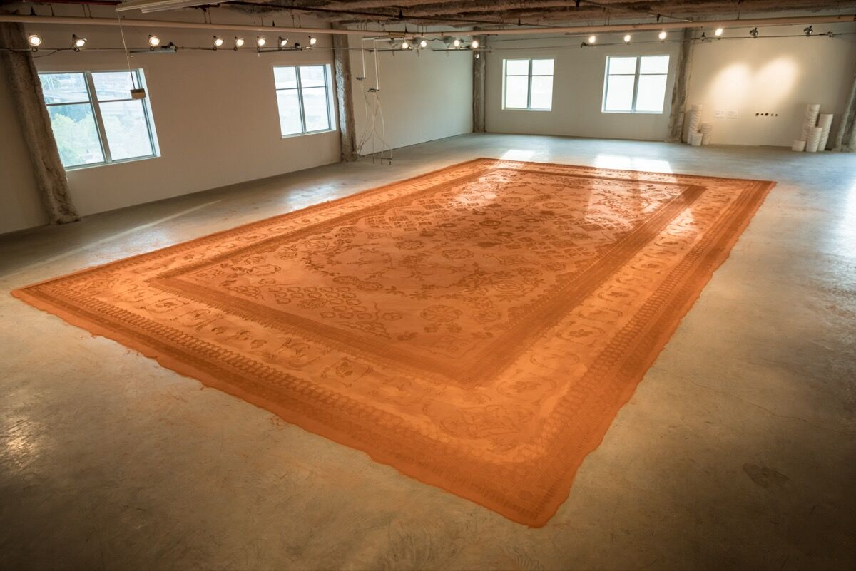 Installation view of Rena Detrixhe, Red Dirt Rug Monument, 2017 at ArtPrize, Grand Rapids, Michigan. Photo by Mark Andrus, courtesy of the artist.