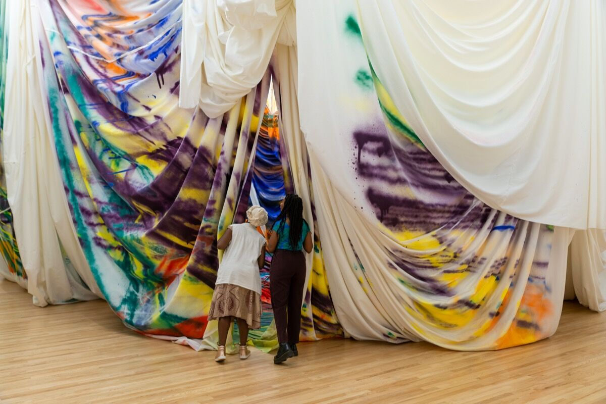 """Installation view of """"Katharina Grosse: Is It You?"""" at The Baltimore Museum of Art, March 2020. Photo by Mitro Hood. Courtesy of The Baltimore Museum of Art."""