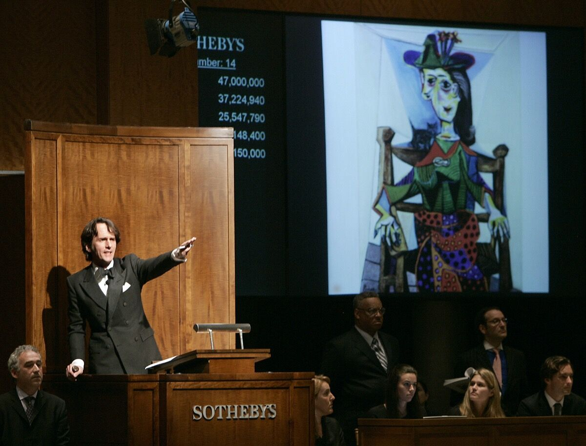 Pablo Picasso's Dora Maar au chat goes to auction at Sotheby's New York during the Impressionist and Modern Art Sale in 2006. Photo by Timothy A. Clary/AFP via Getty Images)