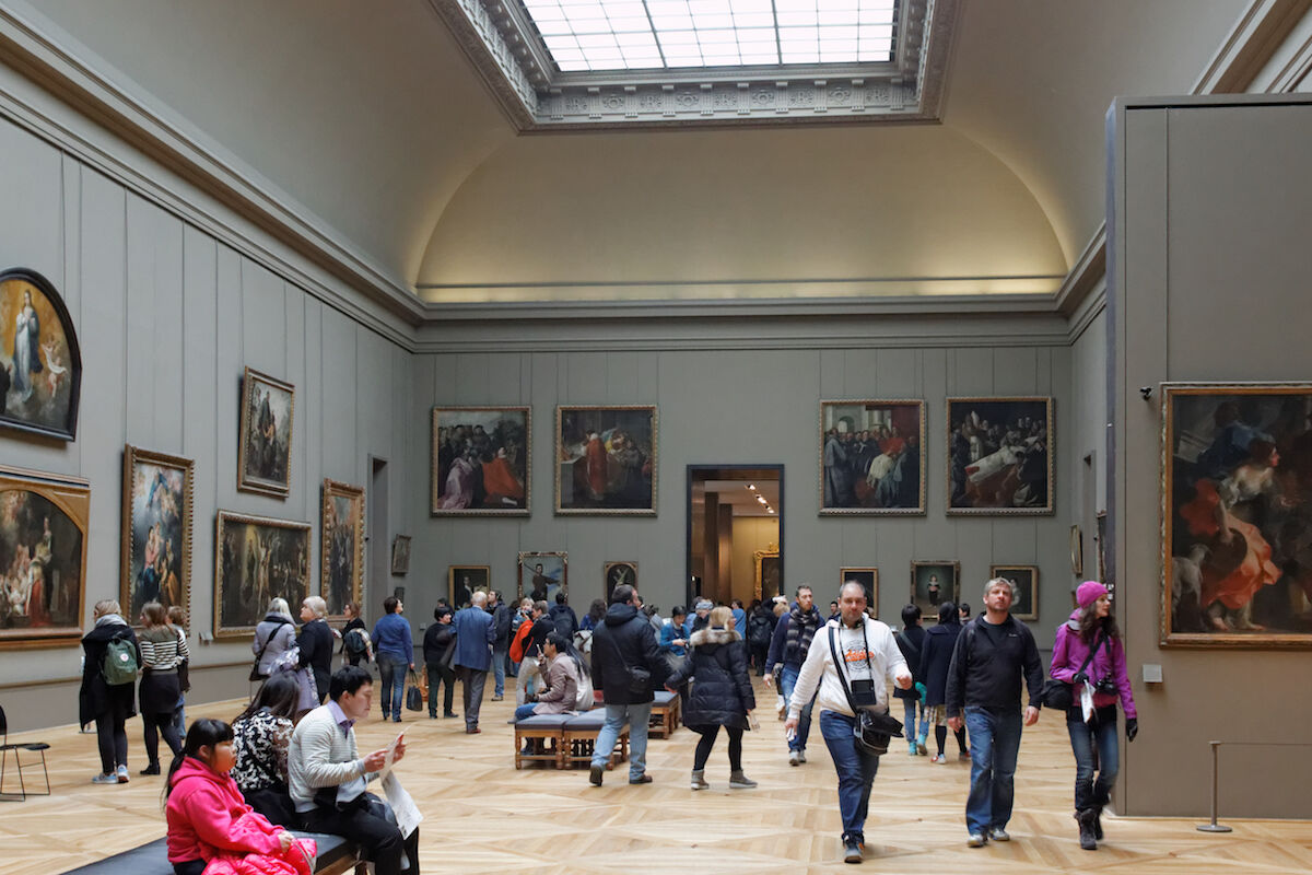 Visitors in the Spanish painting galleries at the Louvre. Photo by Coyau, via Wikimedia Commons.
