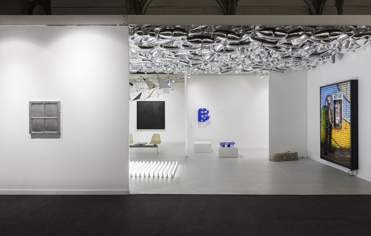 FIAC Booth 0.B12, with works byUgo Rondinone, General Idea, Tomás Saraceno, Jean-Pascal Flavien, and Rodney Graham. Photo by Andrea Rossetti. Courtesy the artists andEstherSchipper, Berlin.