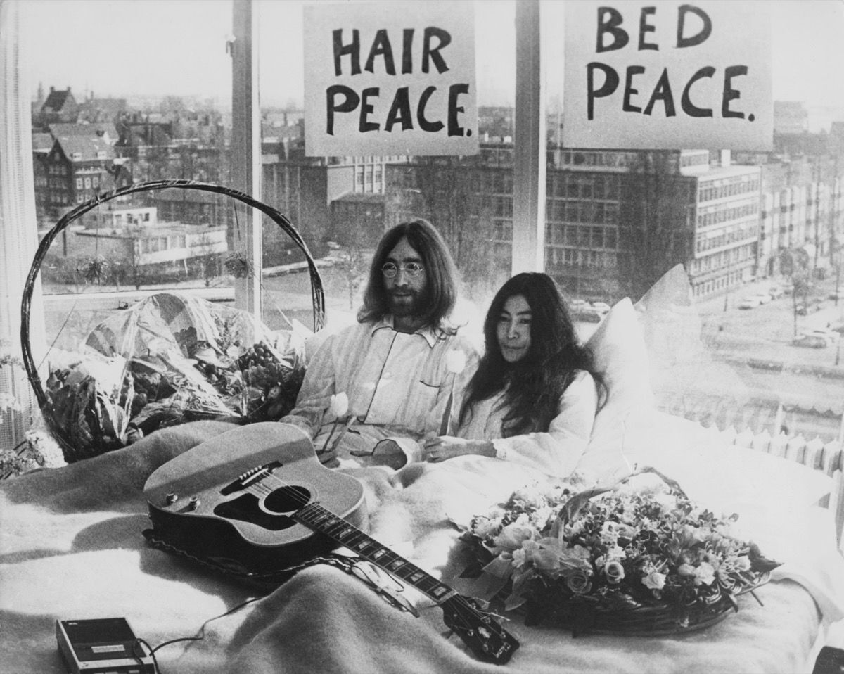 John Lennon and Yoko Ono in their bed in the Presidential Suite of the Hilton Hotel, Amsterdam, 1969. Photo by Keystone/Hulton Archive/Getty Images.