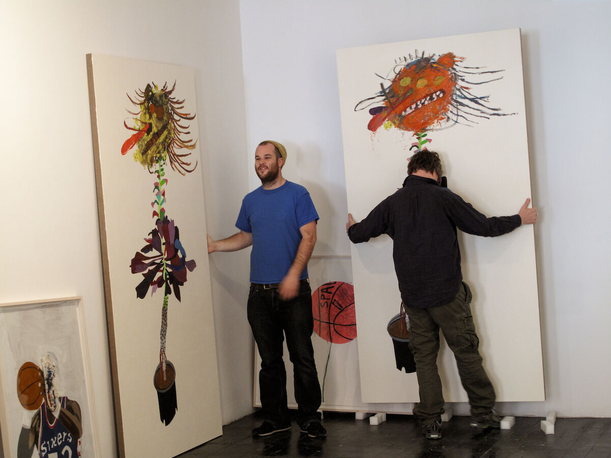 Jonas and Mark Grotjahn during install of their collaborative show at T&SnKreps, New York, 2009. Courtesy of Wood Kusaka Studios.
