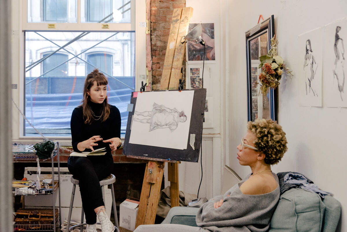MFA student Sarah Sager and visiting artist Amy Sherald during at studio critique at New York Academy of Art. Photo by Daniel Dorsa for Artsy.