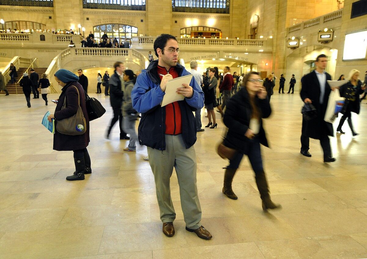 Artist Jason Polan sketching in Grand Central Terminal. Photo by Timothy A. Clary/AFP via Getty Images.