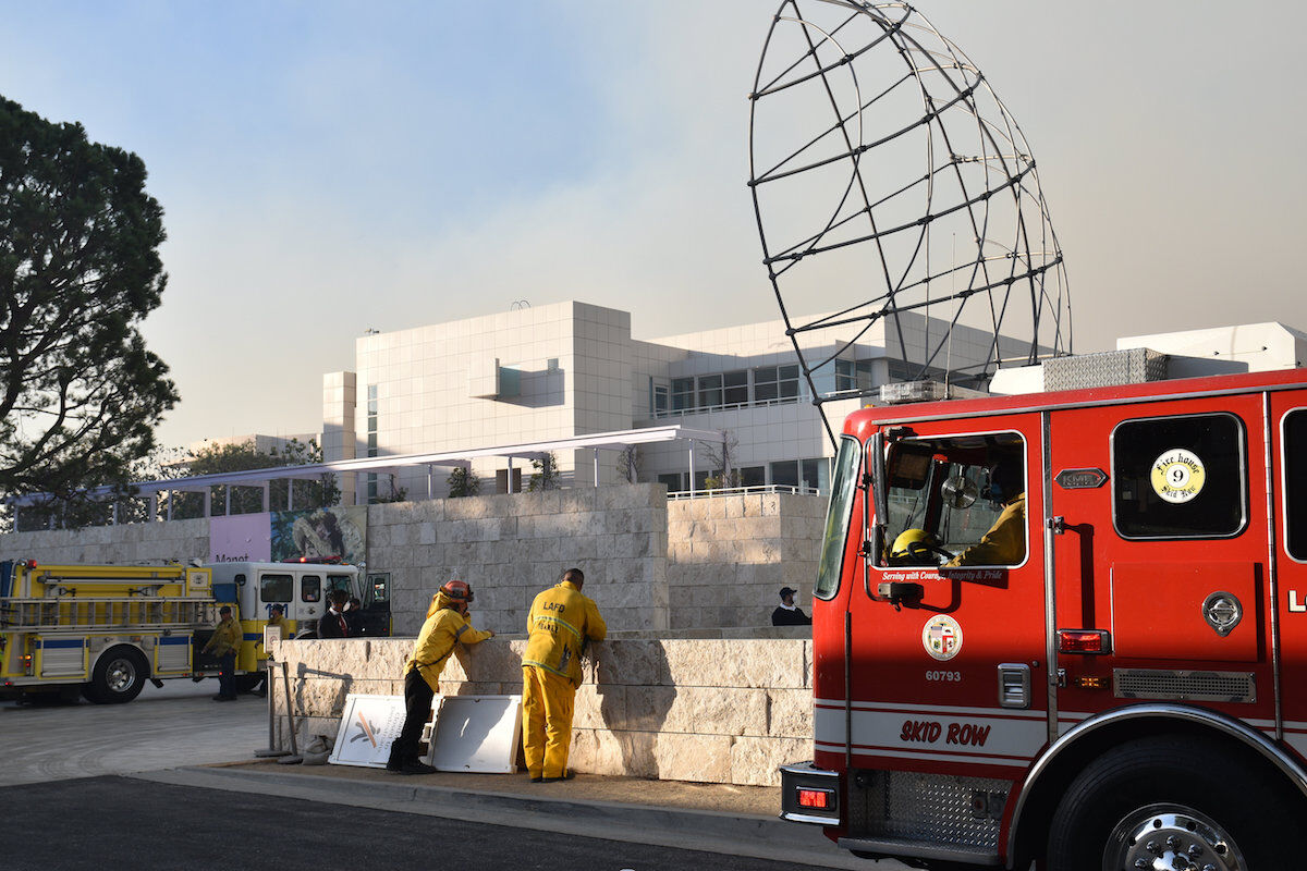Firefighters at the Getty Museum, using it as a staging area to approach the steep terrain around the landmark site during the Getty fire in Los Angeles on October 28, 2019. Photo by Bradley Bermont/ MediaNews Group/Los Angeles Daily News via Getty Images.