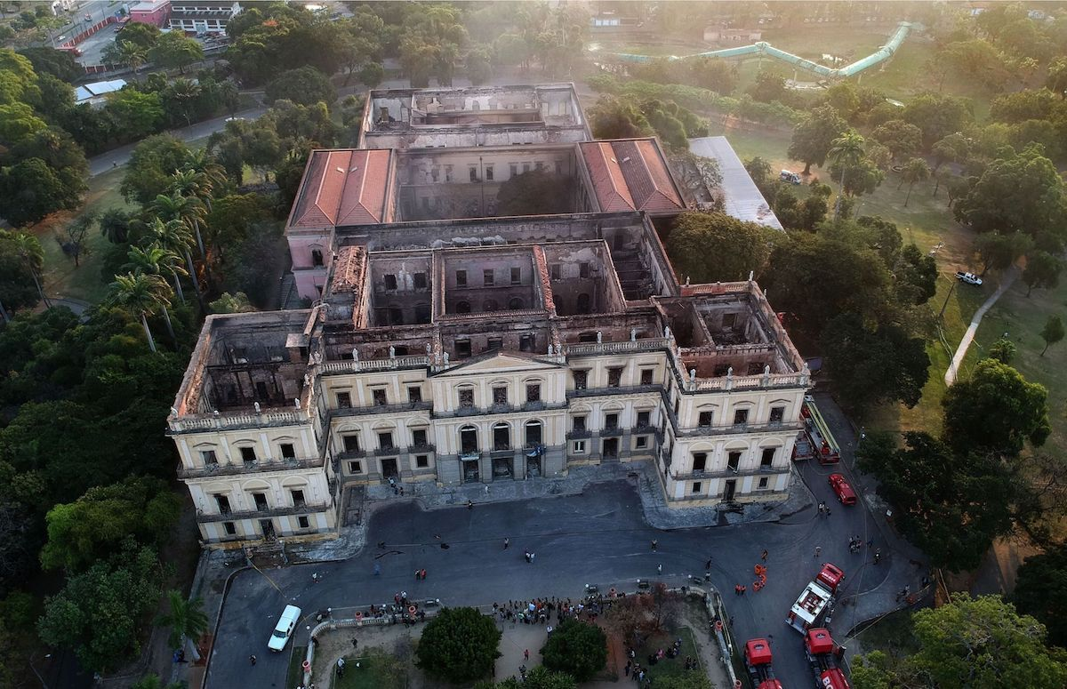 Drone view of Rio de Janeiro's treasured National Museum, one of Brazil's oldest, on September 3, 2018, a day after a massive fire ripped through the building. Photo by Mauro Pimentel//AFP/Getty Images.