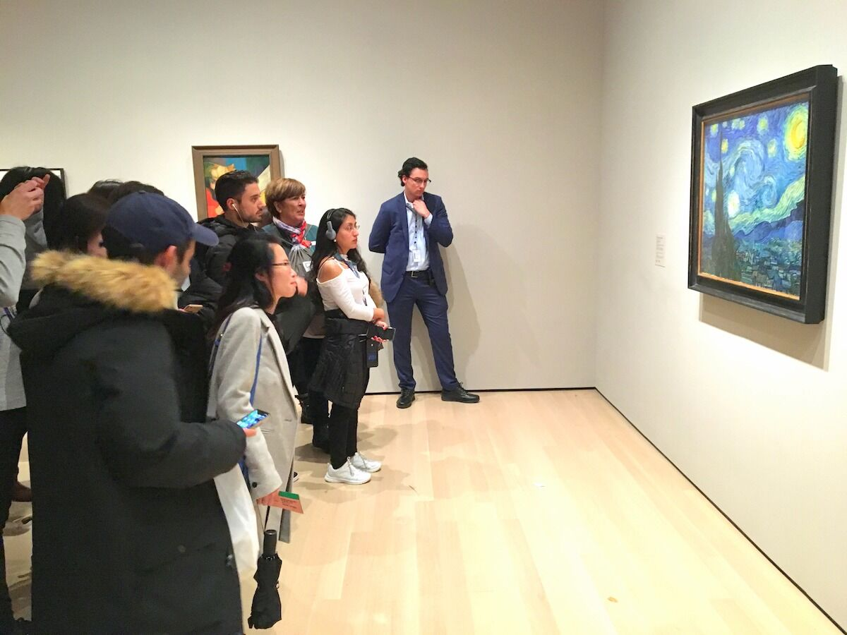 Visitors at the Museum of Modern Art look at a painting by the Dutch artist Vincent van Gogh. Photo by wyliepoon, via Flickr.