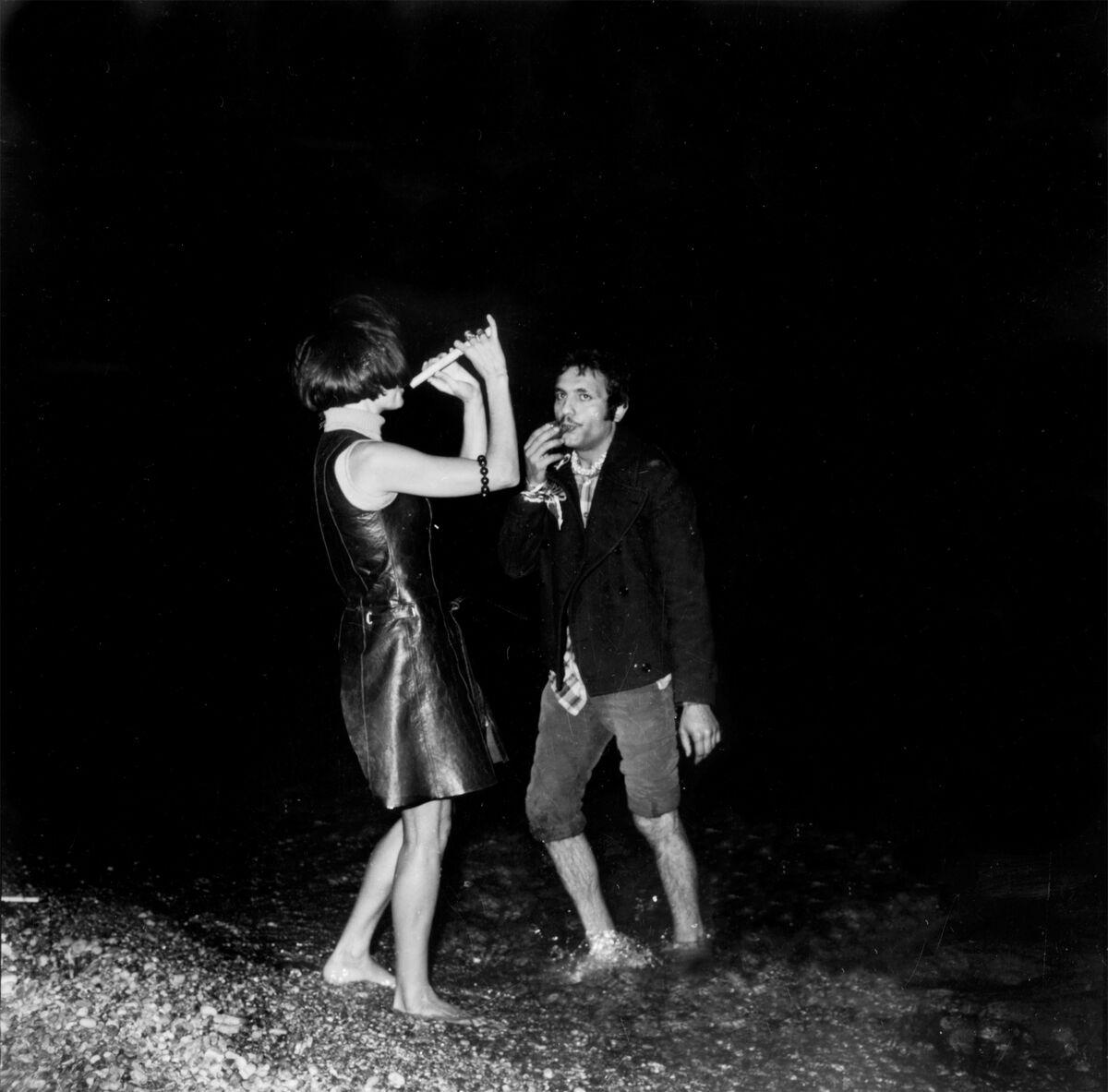 Anne Marie Boetti and Carmine Ableo improvising a small piffero and whistle concert on the Amalfi beach at Arte Povera, 1968. Photo by Bruno Manconi. Courtesy of Archivo Lia Rumma.