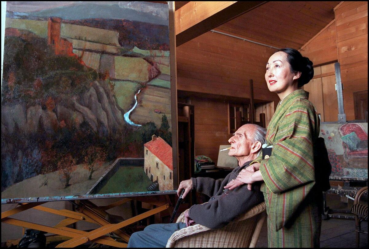 Painter Balthus and his wife Setsuko in their wooden hut of Rossiniere, Switzerland in February, 1998. Photo by Raphael Gaillard/Gamma-Rapho via Getty Images.
