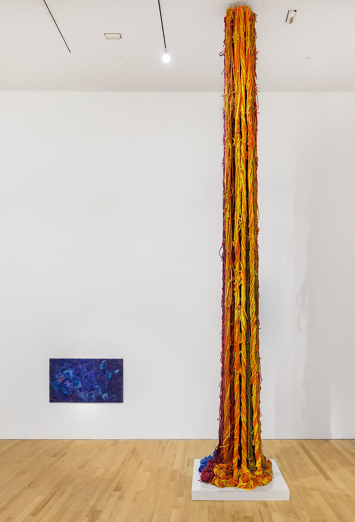 Installation view of Sheila Hicks, Blue Gros Point, ca. 1990, and Questioning Column, 2016, at The Bass, 2019. Photo by Zachary Balber. Courtesy of The Bass, Miami Beach.