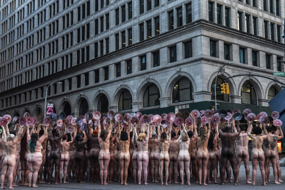 People pose nude holding cut outs of nipples during a photo shoot outside the New York City offices of Facebook by artist Spencer Tunick on June 2, 2019. Photo by Stephanie Keith/Getty Images.