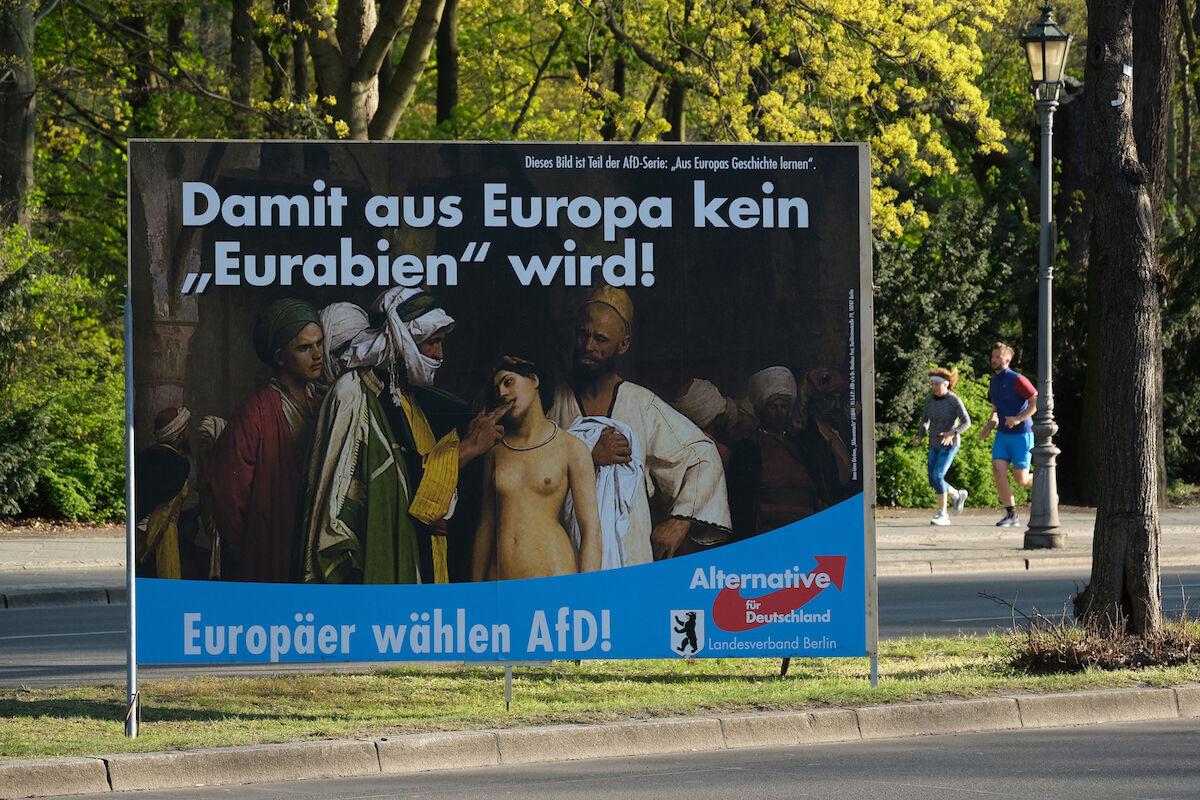 "An Alternative für Deutschland billboard i Berlin featuring the Jean-Léon Gérôme painting ""Slave Market."" Photo by Sean Gallup/Getty Images."