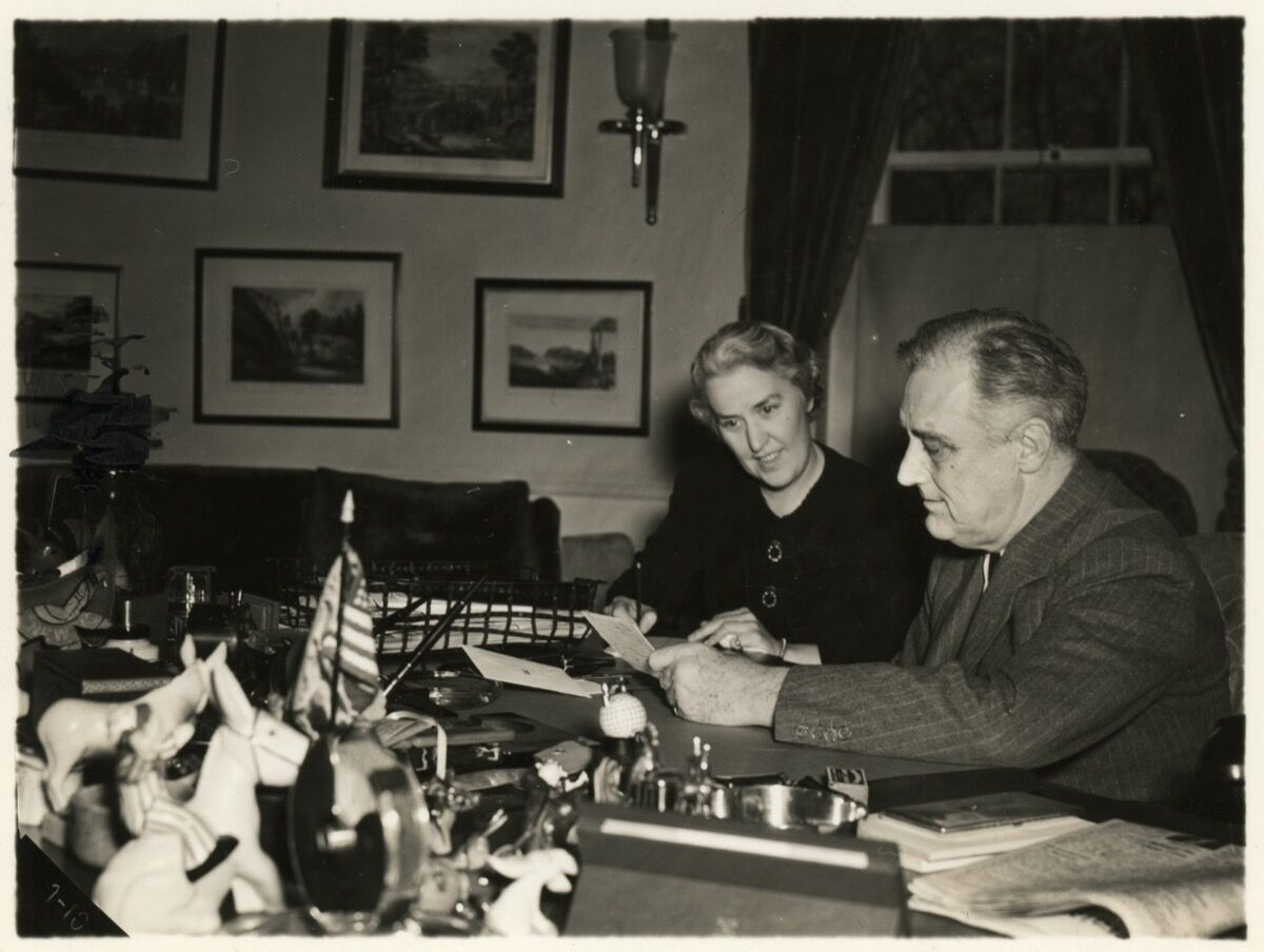"Marguerite ""Missy"" LeHand and Franklin D. Roosevelt pictured working together at the President's desk, May 22, 1941. Photo by FDR Presidential Library & Museum, via Flickr."