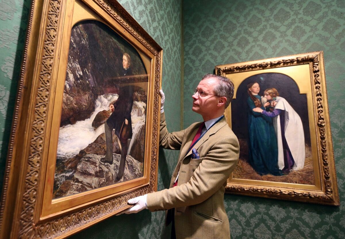 Senior Curator of European Arts Colin Harrison adjusts Portrait of John Ruskin by John Everett Millais that was allocated to the Ashmolean Museum in Oxford by the Arts Council England under the Acceptance in Lieu of Inheritance (AIL) scheme. Photo by Steve Parsons/PA Images via Getty Images.