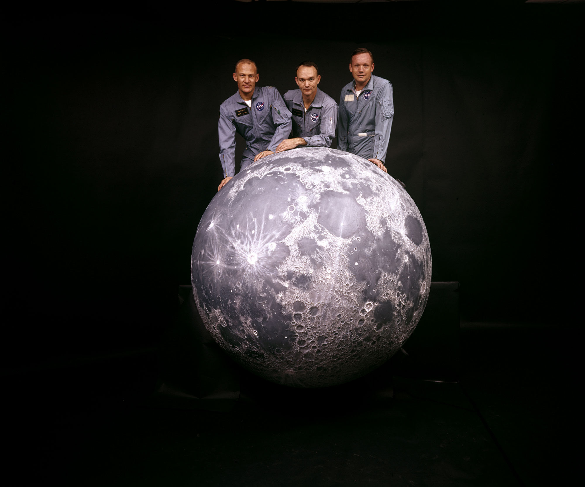 Portrait of American astronauts, from left, Buzz Aldrin, Michael Collins, and Neil Armstrong, the crew of NASA's Apollo 11 mission to the moon, as they pose on a model of the moon, 1969. Photo by Ralph Morse/The LIFE Picture Collection via Getty Images/Getty Images.