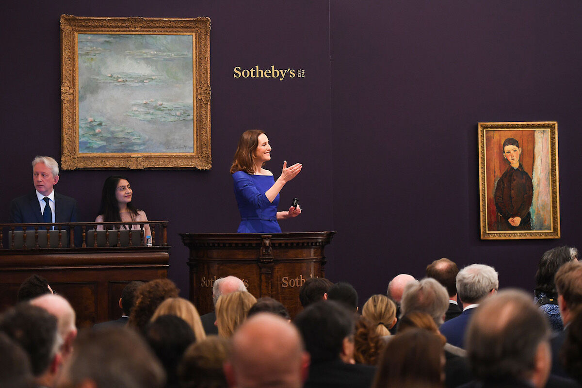 Auctioneer Helena Newman at Sotheby's evening sale of Impressionist and modern art in London. Courtesy Sotheby's.