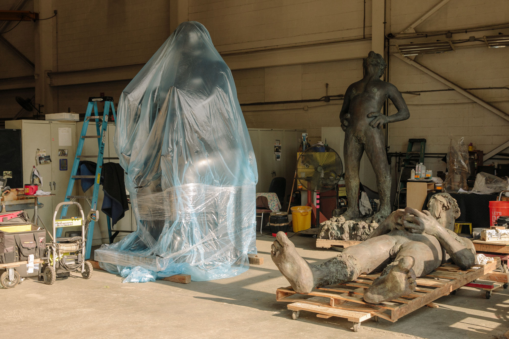 Works by Fernando Botero and Nicole Eisenman in the Polich Tallix art foundry. Photo by Ricky Rhodes for Artsy.