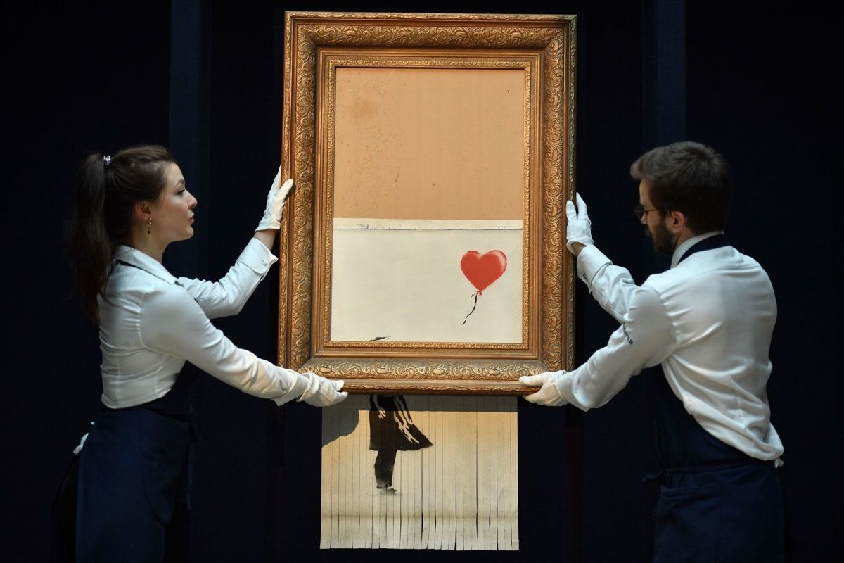 Banksy, Love Is in the Bin, 2018. Photo by Ben Stansall/AFP via Getty Images.