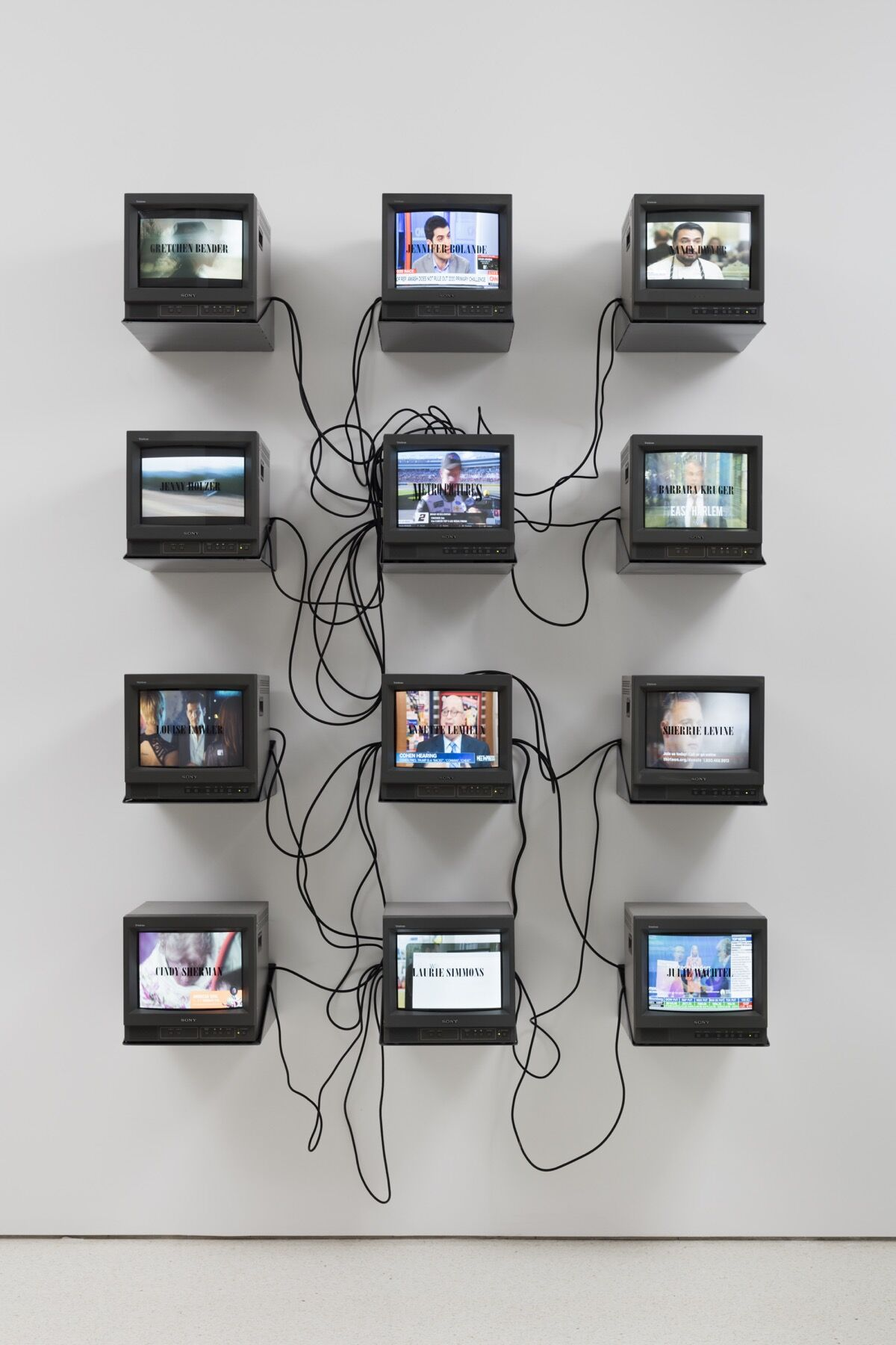 """Installation view of Gretchen Bender, TV, Text, and Image (Metro Pictures Version),  1990, in """"Gretchen Bender: So Much Deathless,"""" Red Bull Arts New York, 2019. Photo by Lance Brewer. © The Gretchen Bender Estate. Courtesy of Red Bull Arts and and OSMOS."""