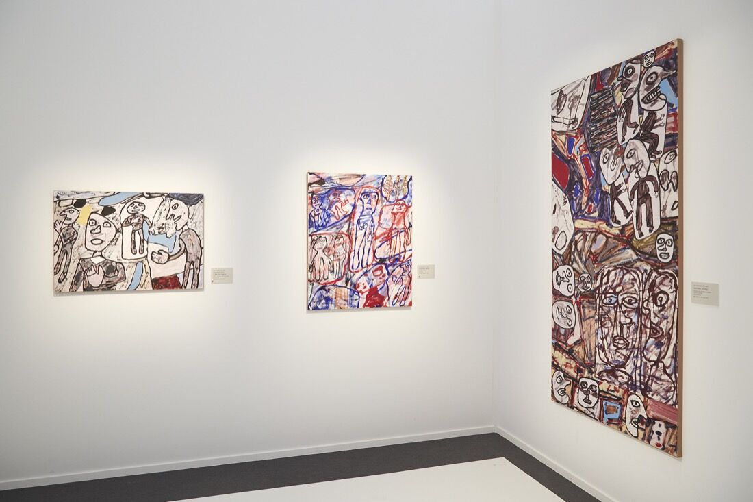 Works by Jean Dubuffet at Helly Nahmad Gallery's booth at Frieze London, 2015. Photo by Benjamin Westoby for Artsy.