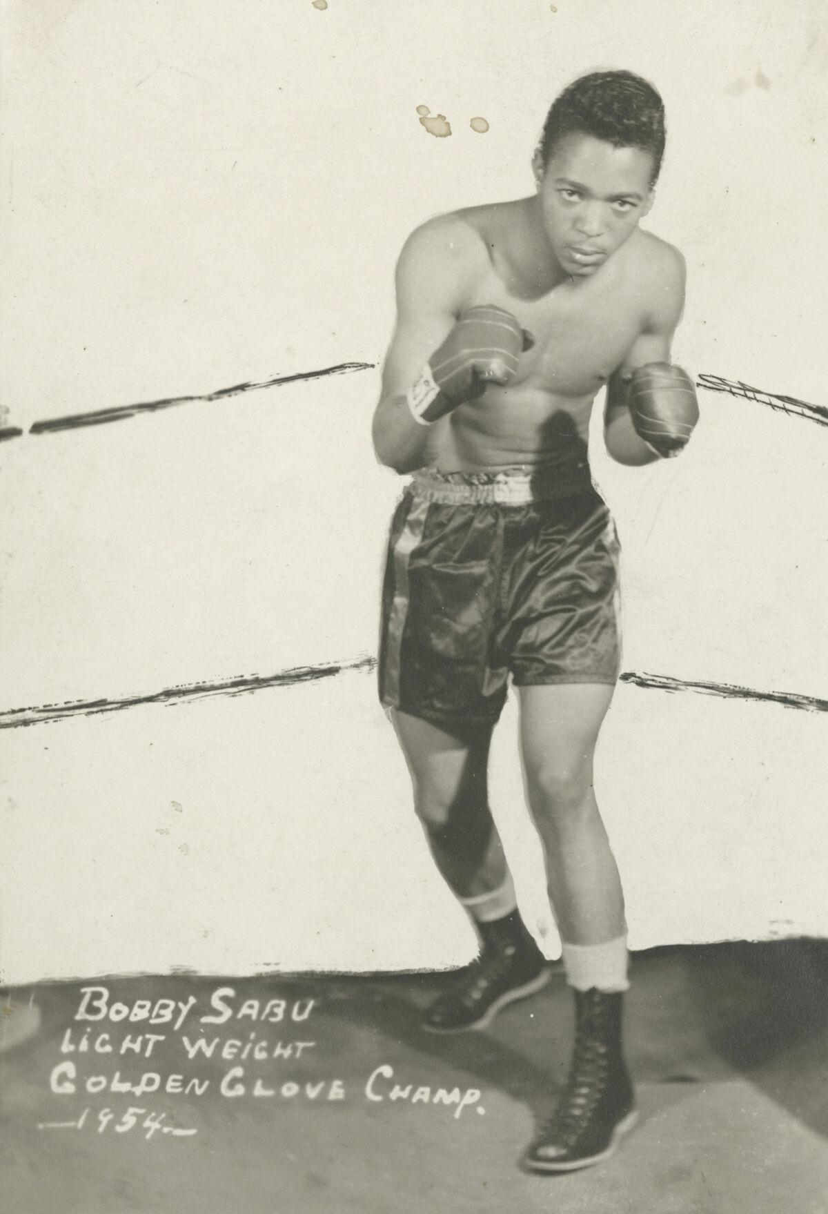 James Van Der Zee, Bobby Sabu, Lightweight Golden Gloves Champ, 1954. © Donna Mussenden Van Der Zee. Courtesy of Howard Greenberg Gallery, New York.