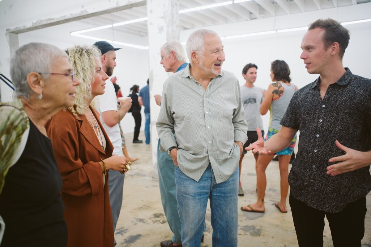 """Emmett Moore with guests at the opening of his exhibition """"Fractured."""" Photo by Gesi Schilling."""