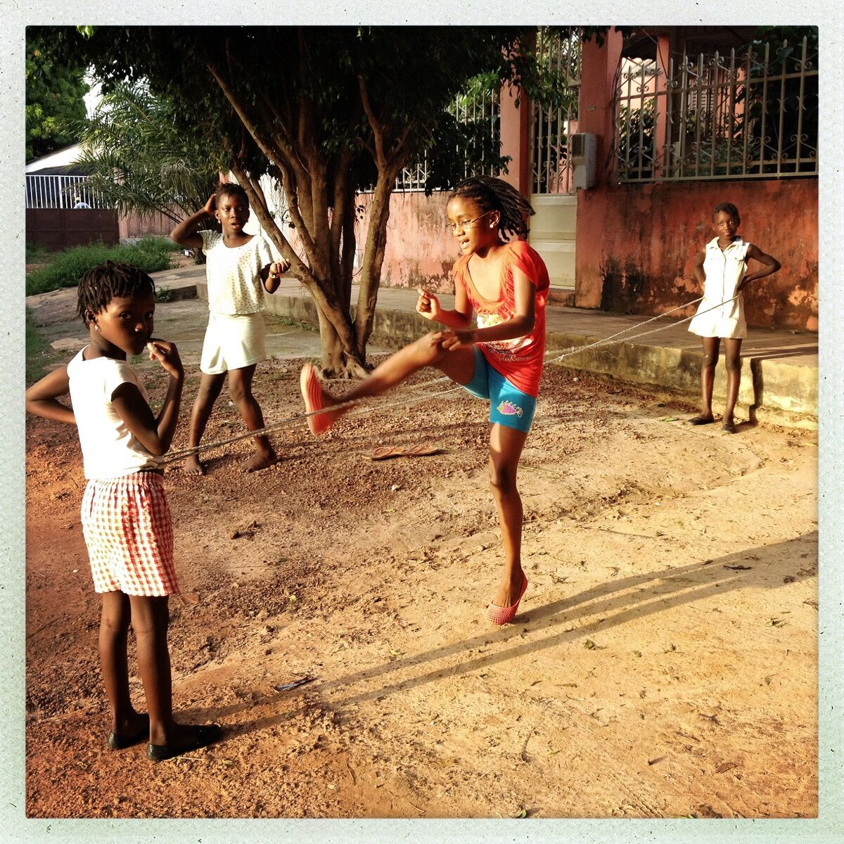 Jump rope in Bissau, Guinea-Bissau. Photo by @hollypickettpix.