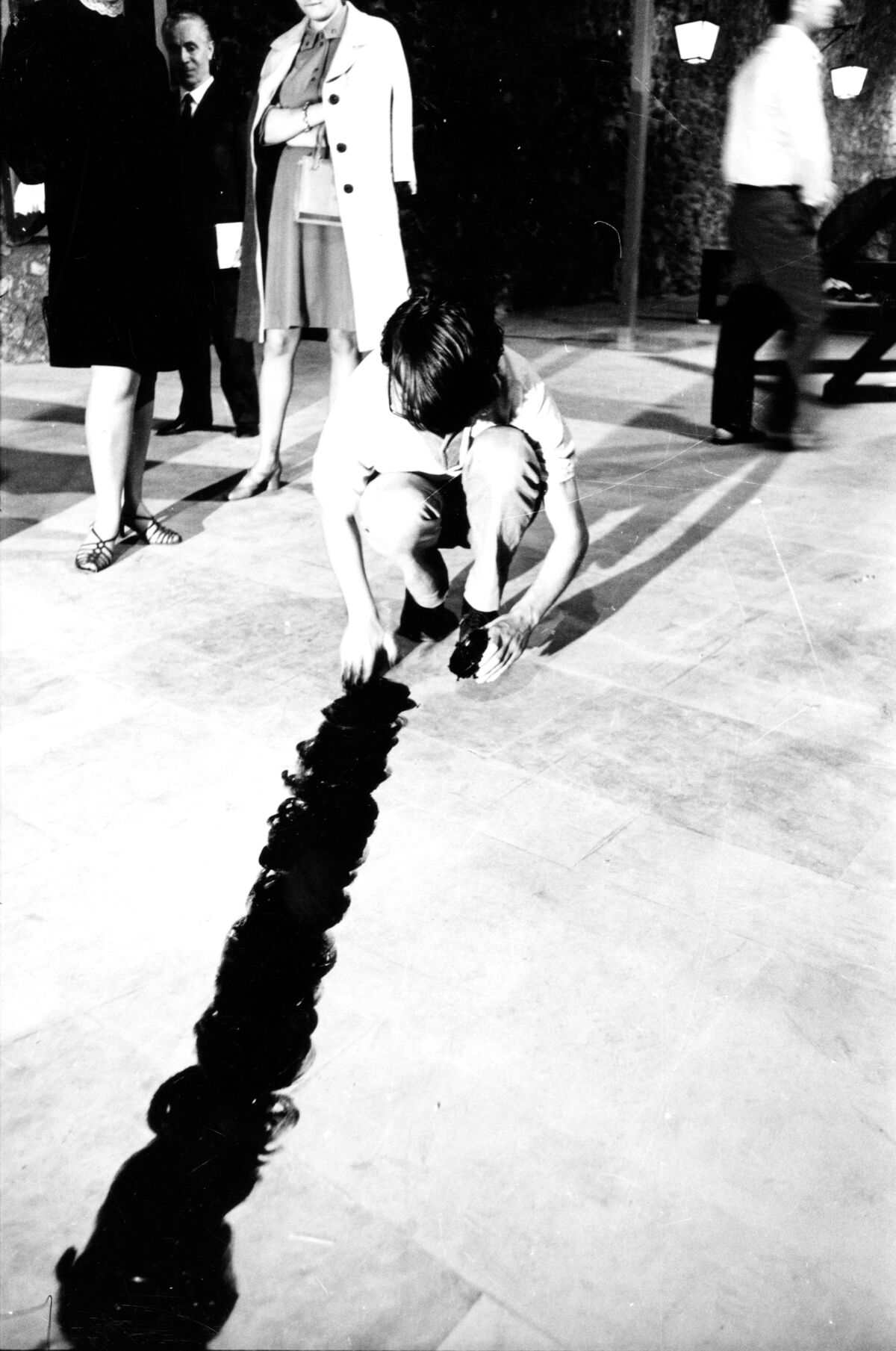 Ger Van Elk painting a line on the floor with shoe polish at Arte Povera, 1968. Photo by Bruno Manconi. Courtesy of Archivo Lia Rumma.
