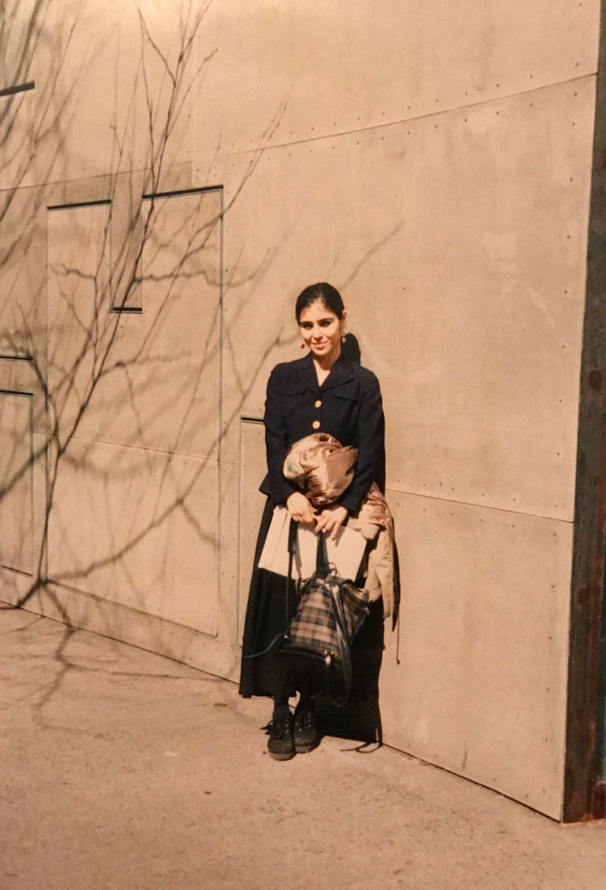 Shirin Neshat in front of the exhibition space, Storefront, in downtown Manhattan circa 1980s. Courtesy of the artist and Gladstone Gallery, New York and Brussels.