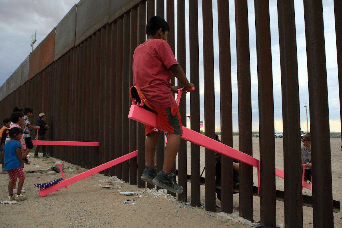 """""""Teetertotter Wall,"""" an installation by Virginia San Fratello and Ronald Rael at the U.S.-Mexico border. Photo by Luis Torres/AFP/Getty Images."""