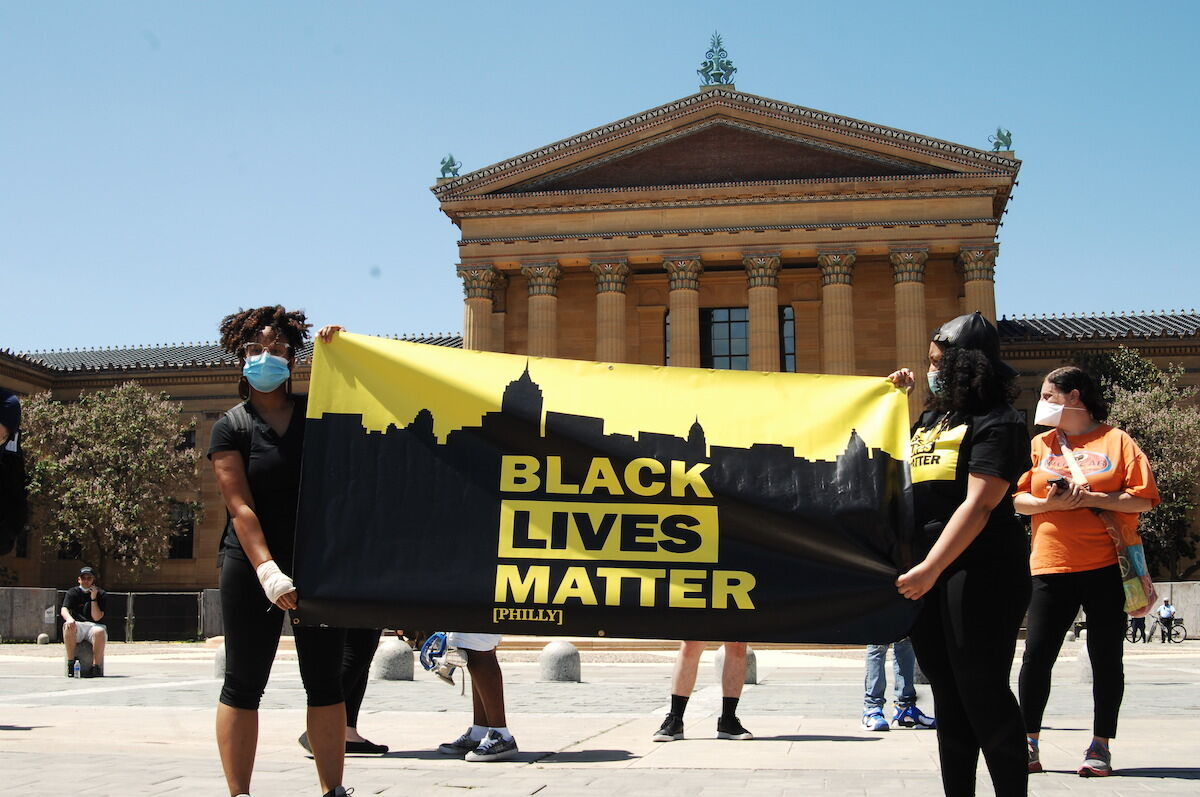 Members of Black Lives Matter, Philly Real Justice, and thousands more rallied on the steps of the Philadelphia Art Museum on May 30th. Photo by Cory Clark/NurPhoto via Getty Images.
