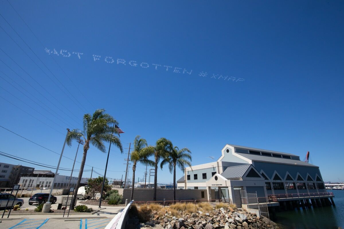 "Tina Takemoto, NOT FORGOTTEN #XMAP, over Terminal Island in Southern California on July 3, 2020, as part of ""In Plain Sight."" Photo by Mark Von Holden. Courtesy of In Plain Sight."