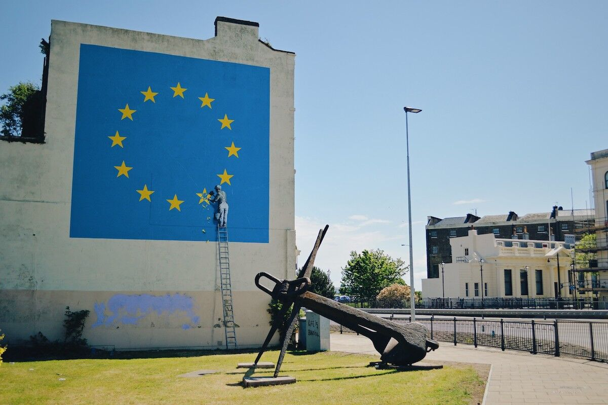 The Brexit-themed Banksy mural in Dover before it was painted over. Photo by Ian Clark, via Flickr.