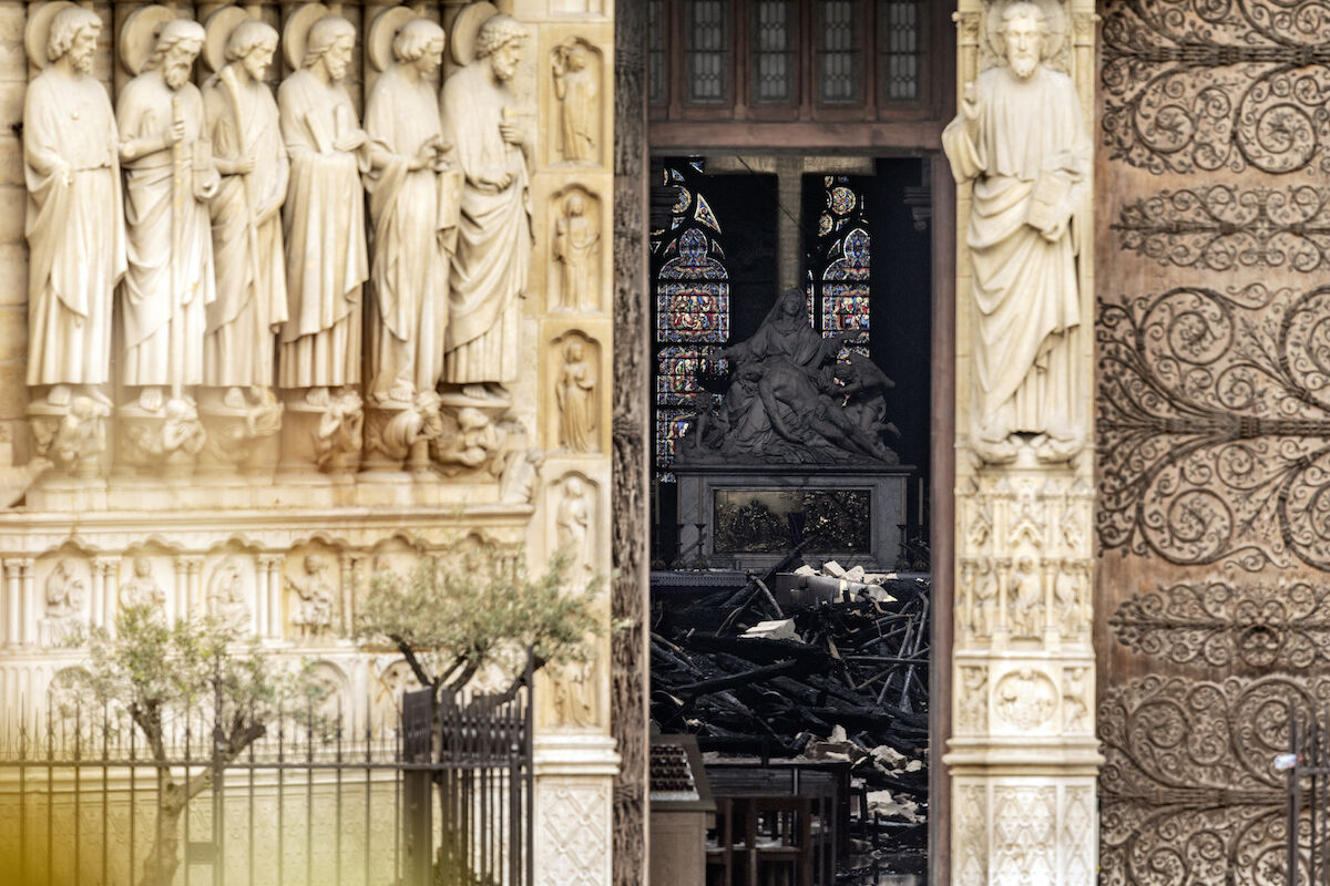 The interior of the Notre Dame Cathedral seen through a doorway following the April 15 fire. Photo by Dan Kitwood/Getty Images.