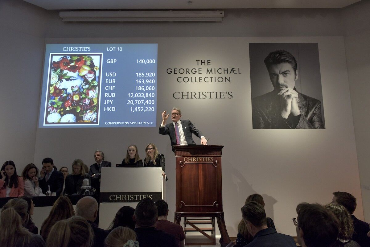 Jussi Pylkkänen, Christie's Global President and auctioneer for the George Michael Collection selling Careless Whisper by Jim Lambie for £175,000 ($232,400). © Christie's Images Limited 2019 / Rankin.