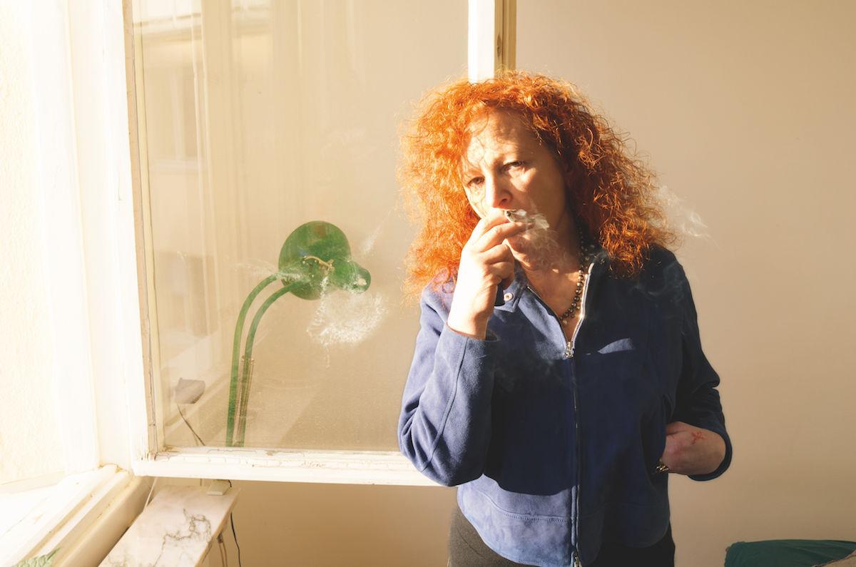 Nan Goldin, Self-portrait smoking, Simon's house, Stockholm, 2013. Courtesy the artist and Marian Goodman Gallery New York, Paris, and London.