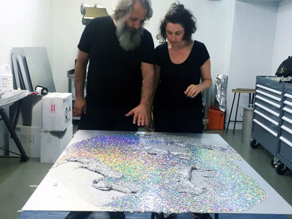 Birol Demir and Yasemin Baydar working in their shared studio, :mentalKLINIK. Courtesy of the artists.