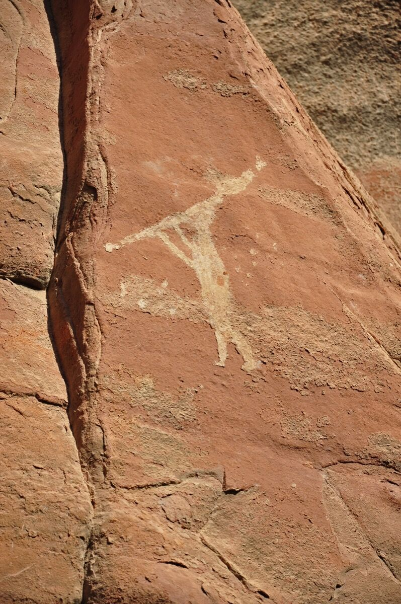 "Pictograph of the prehistoric shamanic symbol ""Kokopelli"" at the Honanki Heritage Site, Coconino National National Forest, Arizona, 2009. Photo by Brady Smith, via Wikimedia Commons. Courtesy of USDA Forest Service, Coconino National Forest."