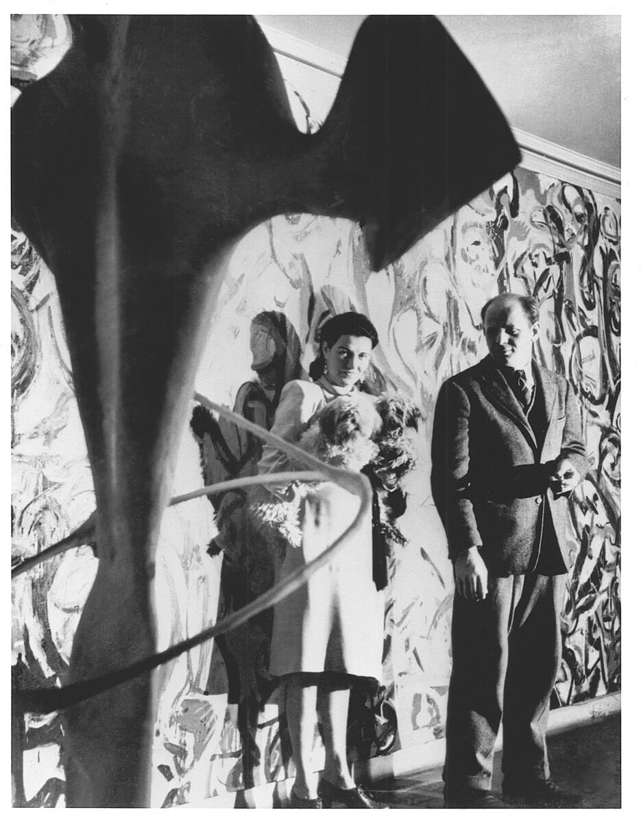 Peggy Guggenheim and Jackson Pollock in front of Pollock's Mural, 1943. © Foto George Kargar. Image courtesy of The University of Iowa.