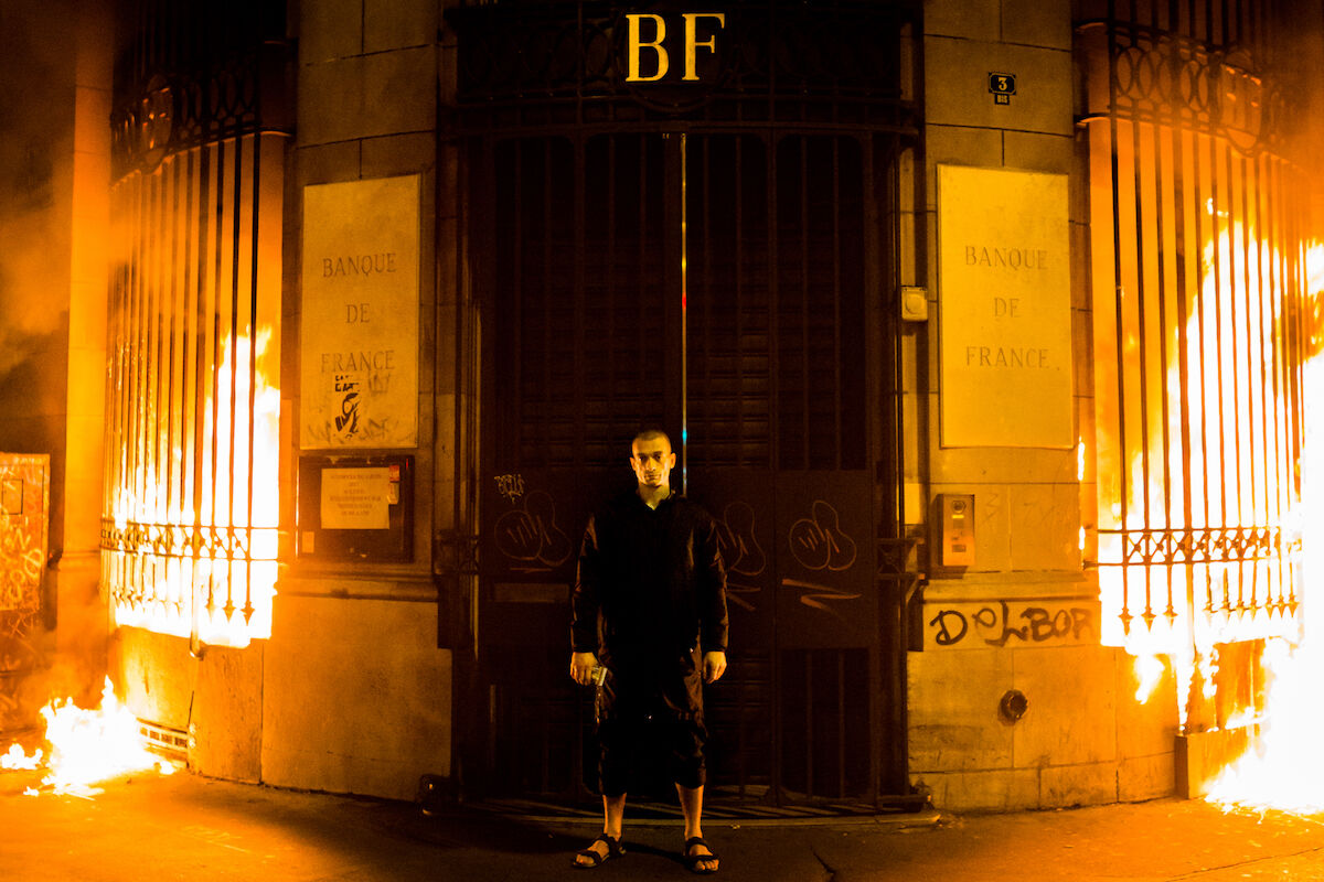 Pyotr Pavlensky after setting fire to the Banque de France building for a performance in 2017. Photo by Skin Cross, via Wikimedia Commons.