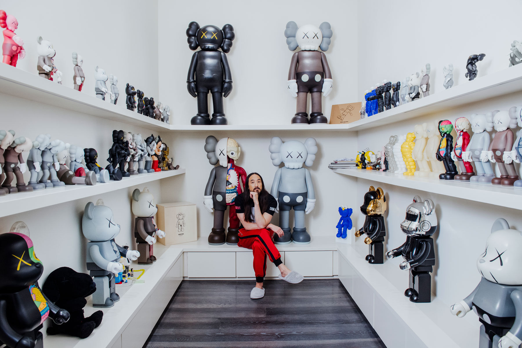 "KAWS is Aoki's favorite artist, and a whole room in his house is dedicated to the artist. ""I'm a toy guy, I started as a toy guy, and KAWS has got limitless toys…and it's attainable,"" Aoki says. ""It's not like each toy is 100 grand."" Photo by Brian Guido for Artsy."