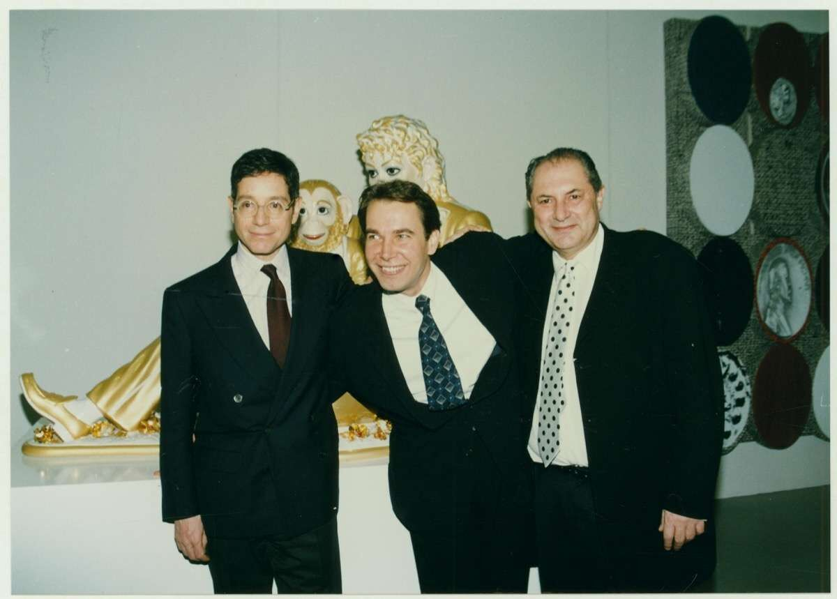 """Jeffrey Deitch, Jeff Koons, and Dakis Joannou at the opening of the exhibition """"Everything That's Interesting Is New,"""" The Dakis Joannou Collection, The Factory, Athens School of Fine Arts, Athens, 1996."""