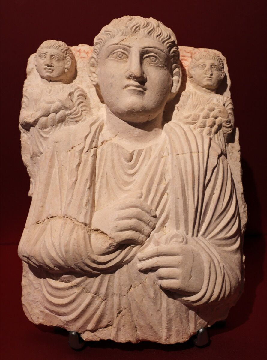 Funerary relief sculpture of a man and his two sons. Image via Wikimedia Common
