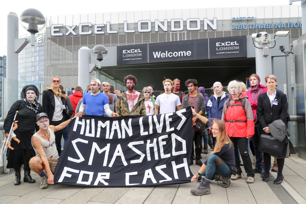 Protesters affiliated with the group Campaign Against Arms Trade outside the 2017 edition of the Defence and Security Equipment International arms fair in London. Photo by Diana More for Campaign Against Arms Trade, via Flickr.