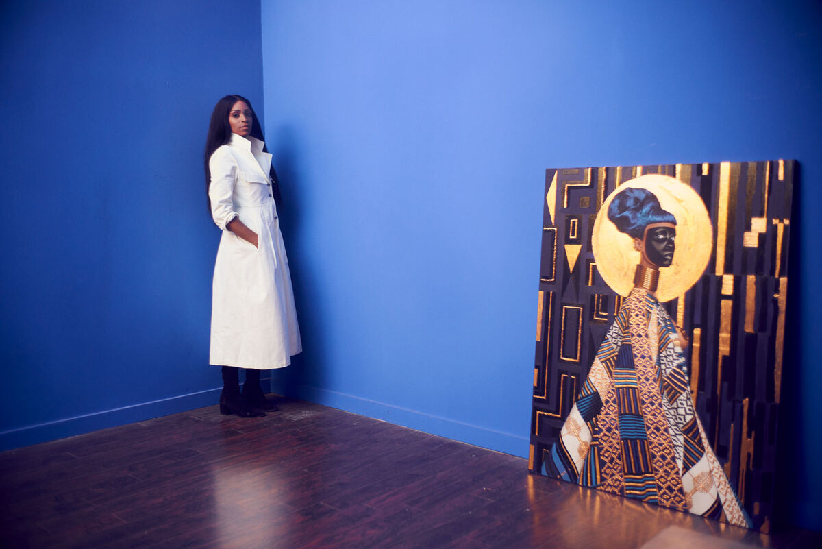 Portrait of Lina Iris Viktor with her painting Syzygy, 2015. Photo by Alex John Beck for Artsy.