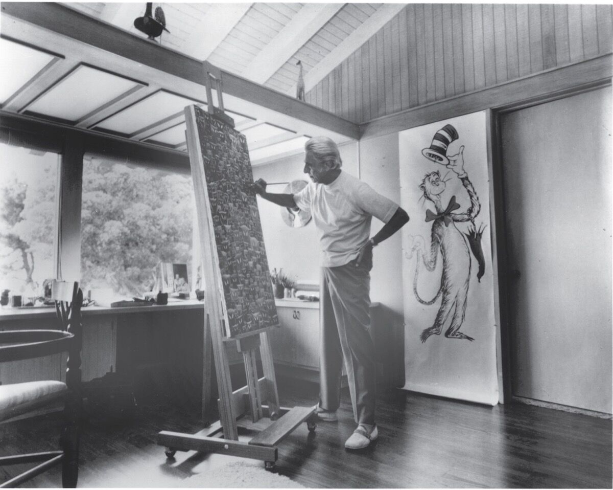 Theodor Seuss Geisel at his easel. © 2018 Dr. Seuss Enterprises, L.P. All Images All Rights Reserved.