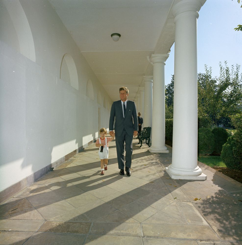 President John F. Kennedy walks with his son along the West Wing Colonnade of the White House, 19. Photo by Robert Knudsen. Courtesy of White House Photographs and the John F. Kennedy Presidential Library and Museum, Boston.