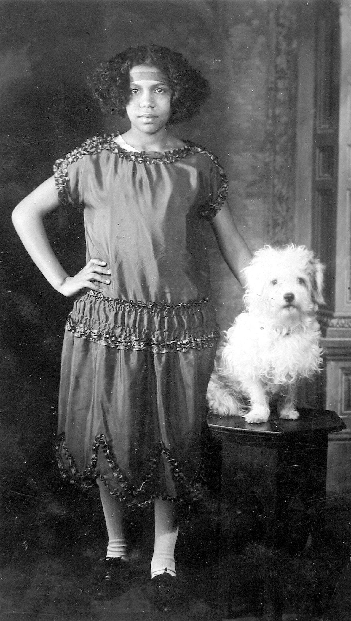 James Van Der Zee, Young Girl with Dog, 1921. © Donna Mussenden Van Der Zee. Courtesy of Howard Greenberg Gallery, New York.